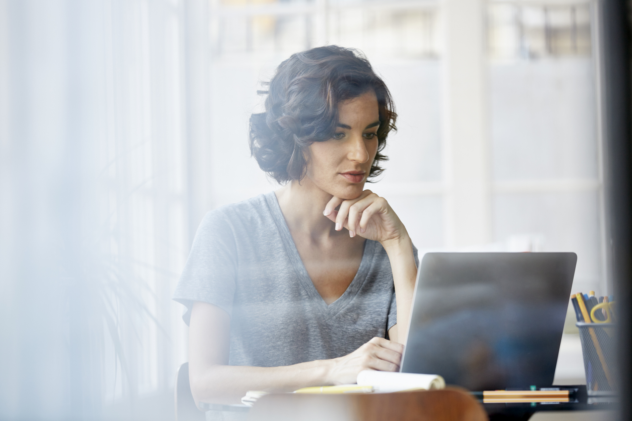 A woman uses her computer to research her credit report