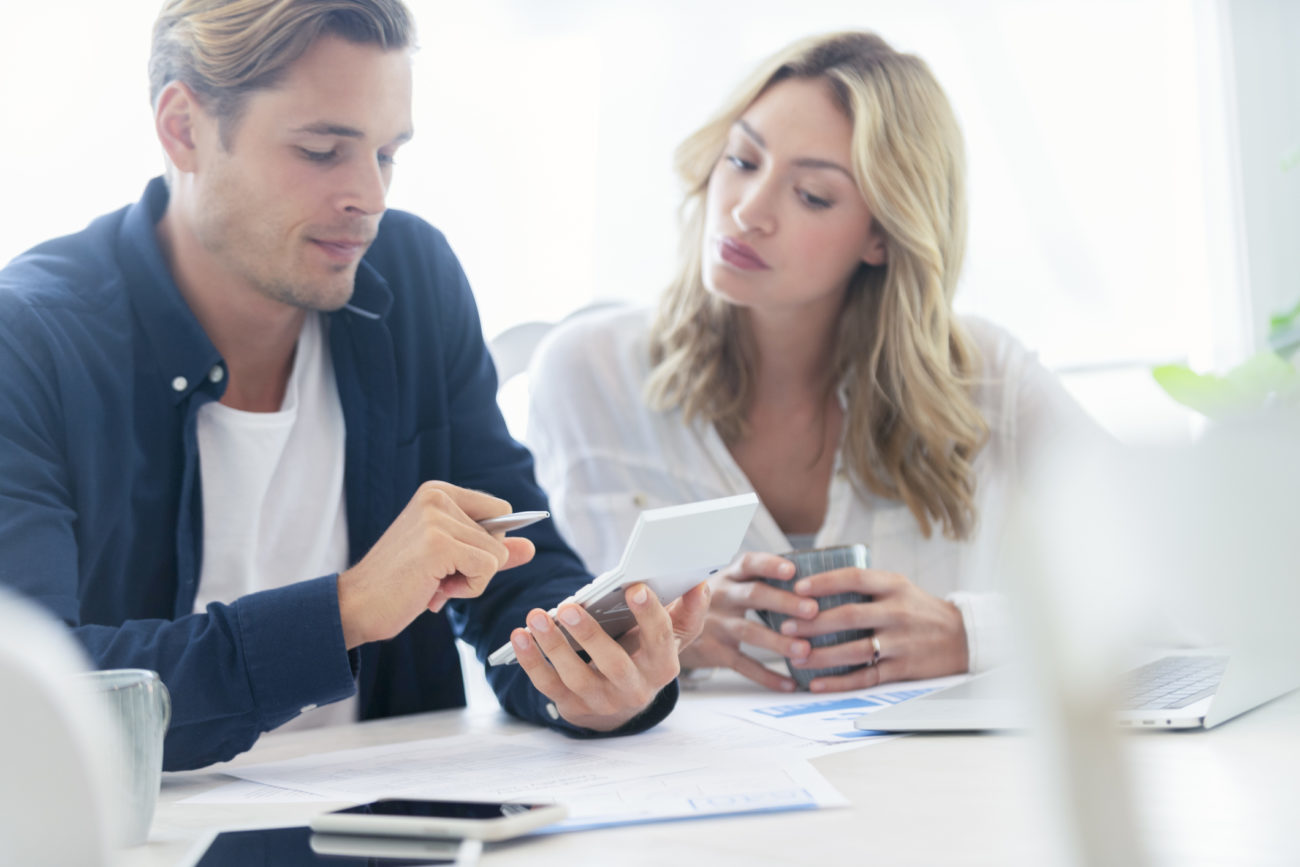 Young couple applying for a personal loan online